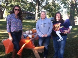 picture: League members Margarita Fuksman, Katie Piere and Susan Mize prepare for the fall Treat Our Troops event at Schaake's pumpkin patch.